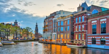 Amsterdam canals with bridge and typical dutch houses in Netherl