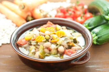Vegetable soup, typical Italian soup with tomatoes, zucchini, po