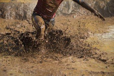 Mud race runners