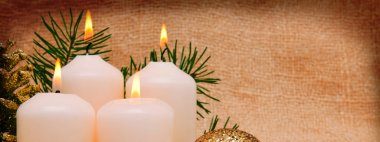 Four white Advent candles .