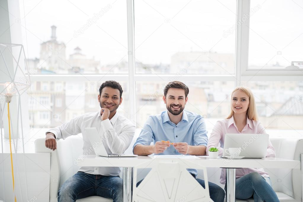 Group of diverse designers in their modern office