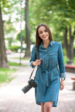 Carefree young girl wants to photograph nature