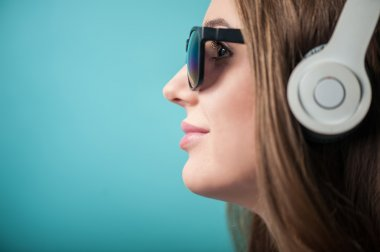 Cheerful Hipster woman with headphones and glasses