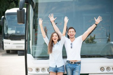 Pretty loving couple is traveling by public transport