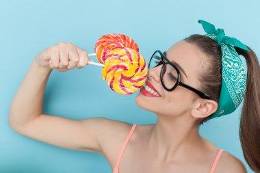 Beautiful young hipster girl is enjoying sweet food