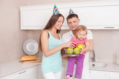 Cute young family is celebrating their housewarming