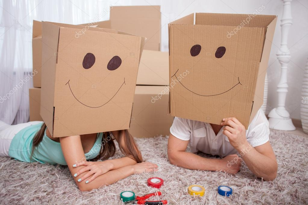 Young friendly family is making fun with packing