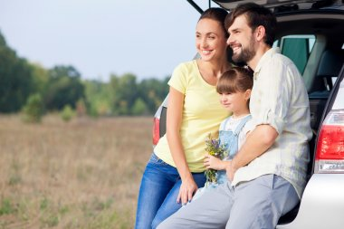 Beautiful friendly family is making journey by vehicle