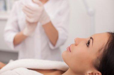 Professional expert beautician is serving her patient