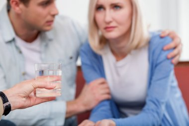 Young husband and wife are consulting marriage therapist