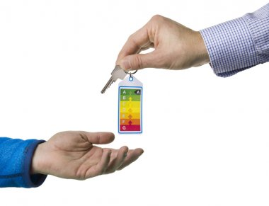 Energy label and key handed over by realtor