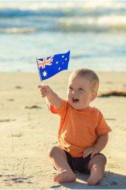 Happy kid with flag of Australia