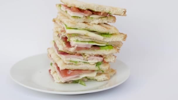 very tall sandwich on white isolated background close-up