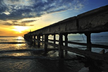 Under the pier in the sunrise