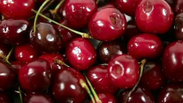 red juicy cherries on the plate. the clockwise rotation.