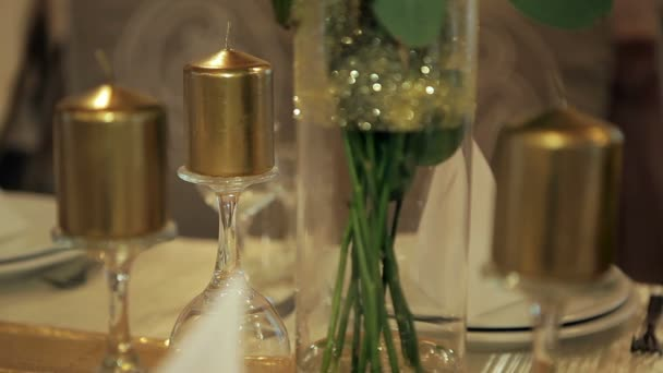 Golden candles on the table