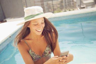smiling girl using phone