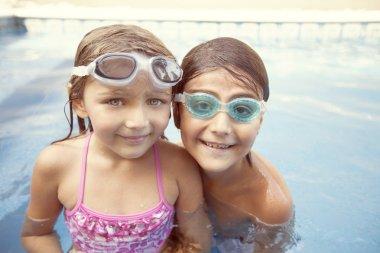 Children relaxing in pool
