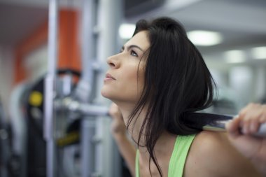 Woman exercising in fitness center