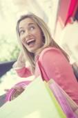 Fényképek nő gazdaság bevásárló táskák