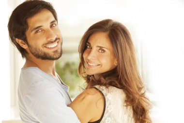 Man and beautiful woman smiling
