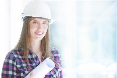 architect holding blueprints