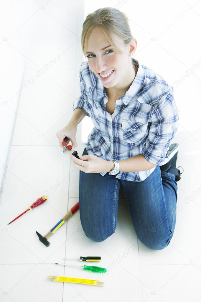 woman working at home and using tools
