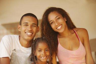 smiling family posing