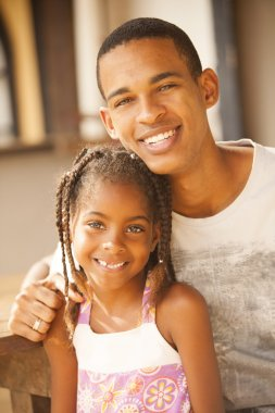 Man and little girl smiling
