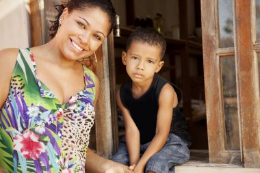 Woman and her son posing