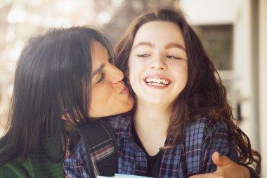 Mother kissing  girl