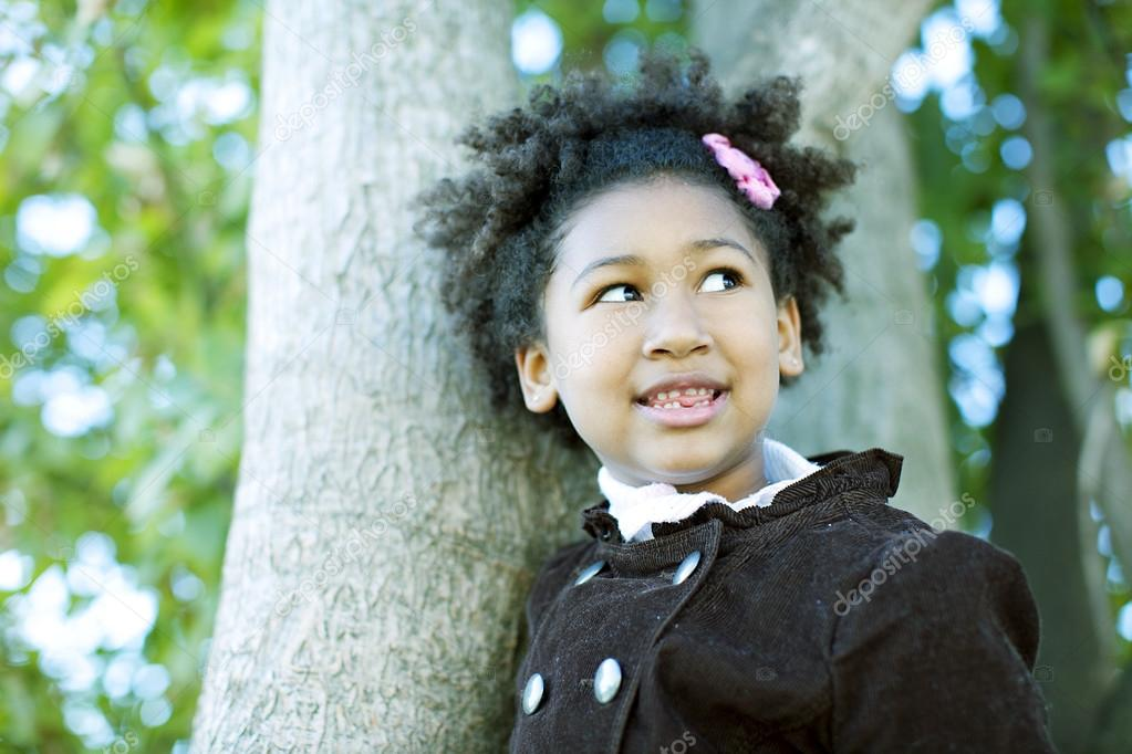 Smiling girl posing outdoors