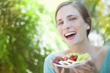 Woman hoding fruit salad