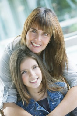 Girl and mother smiling