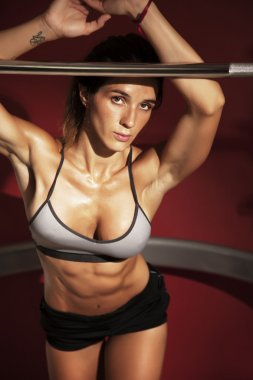 Woman posing in gym