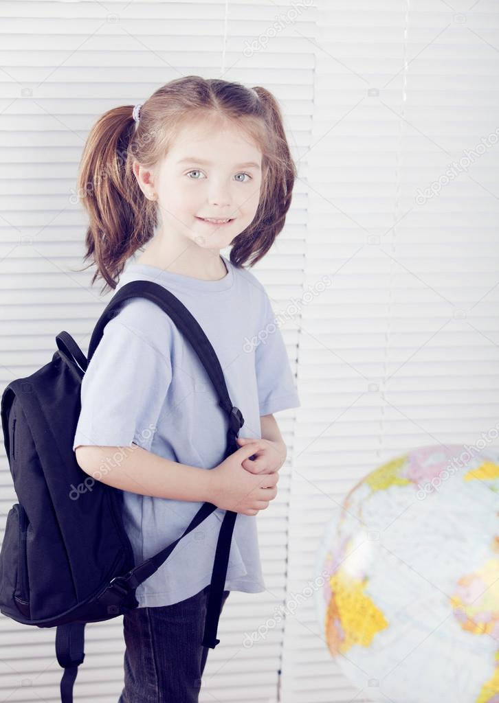 girl with backpack standing