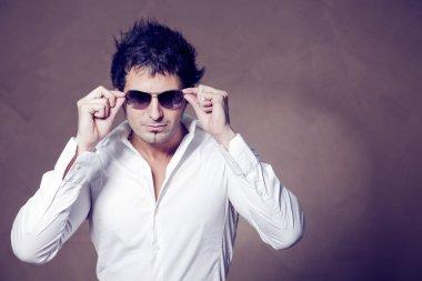 handsome man  holding glasses