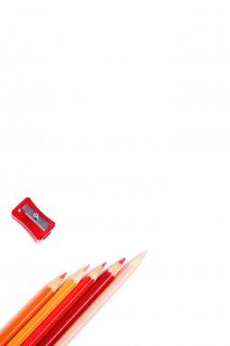 Multicolored pencils and sharpener
