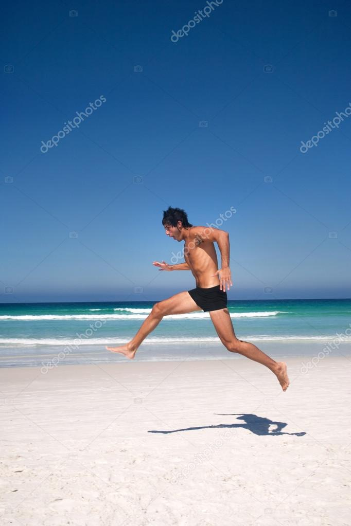 man having fun on the beach