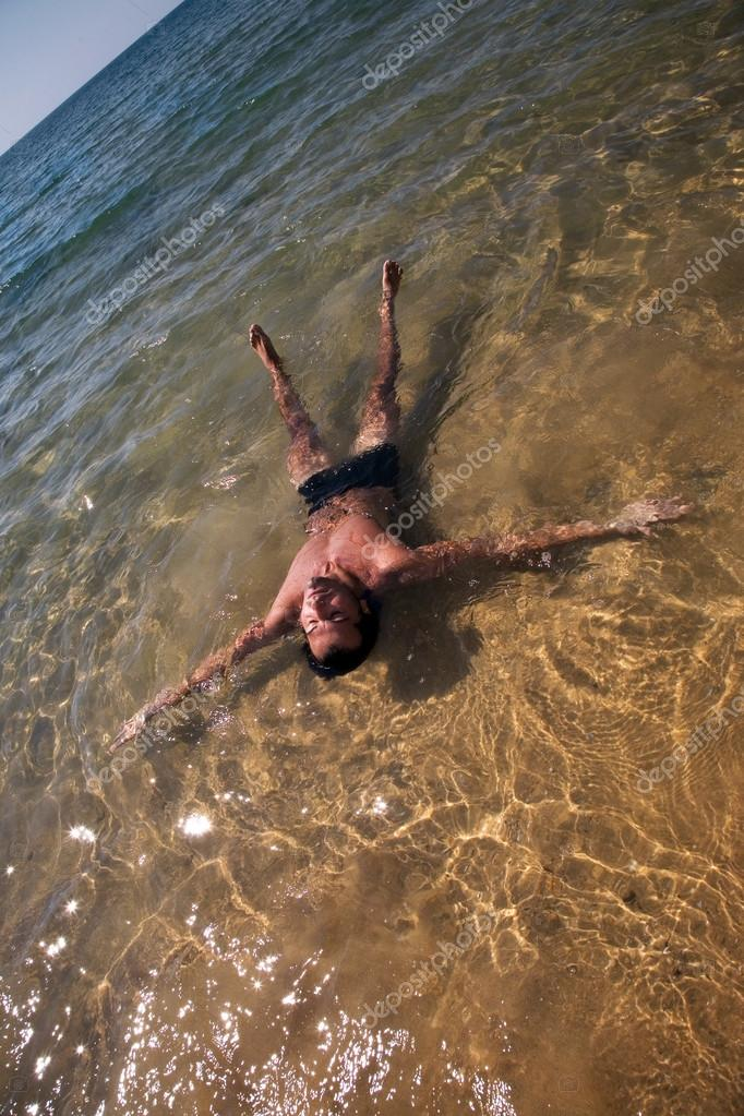 Man  flotating in the ocean