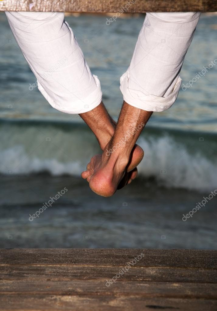 male  feet on the beach