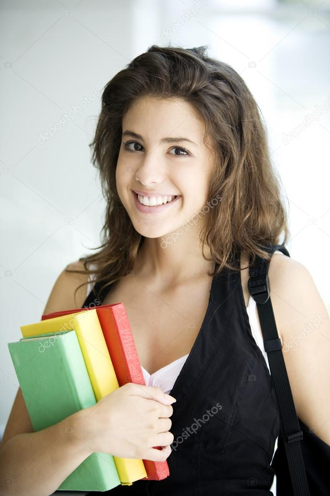 smiling girl holding books