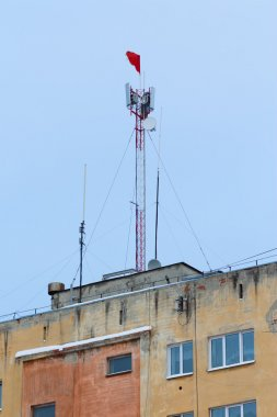 gsm tower due to the red flag on old building