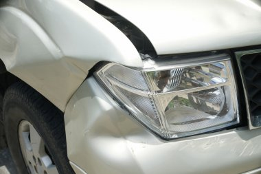 A dent on the right front of a pickup truck (damage from crash)
