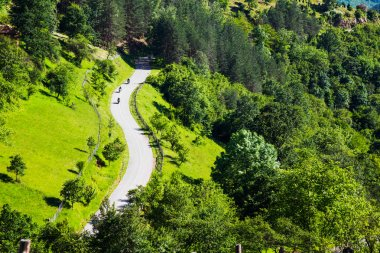 Aerial view of three motorcyclists on a rural road