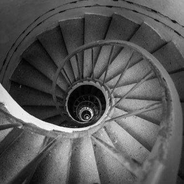 spiraling stairs black and white