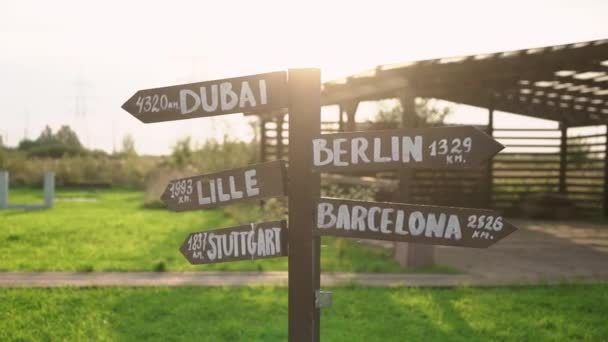 Old wooden road sign - Dubai, Berlin, Lille, Barcelona, Stuttgart