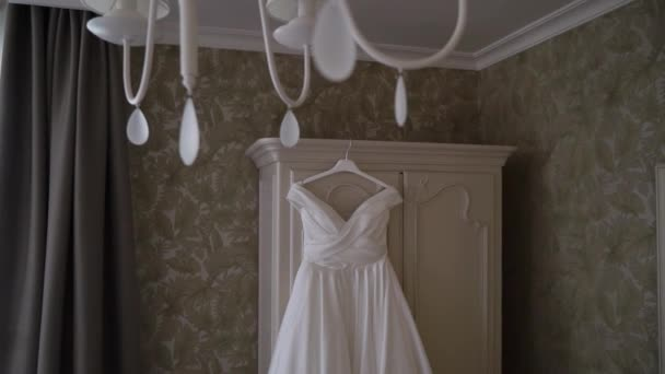 White wedding dress gown of the bride in bedroom