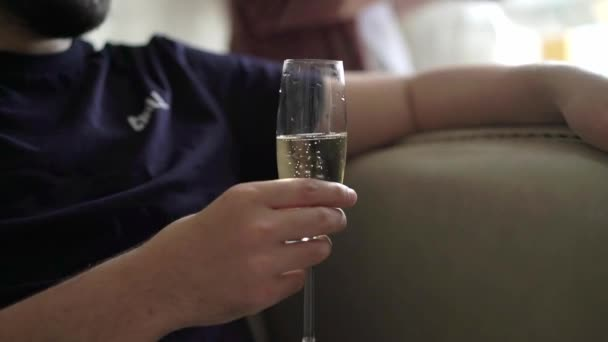 Man sitting with glass of champagne