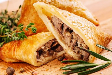 Delicious samosa pies with meat on plate. Menu, restaurant, recipe concept.